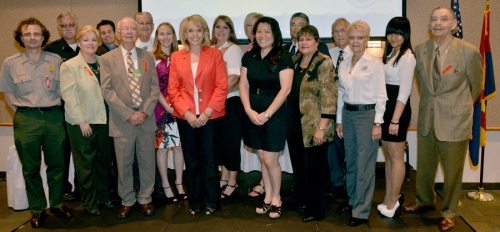 Governor Brewer (center) will recipients of the 11th annual service and volunteerism awards (Photo: Office of the Arizona Governor)