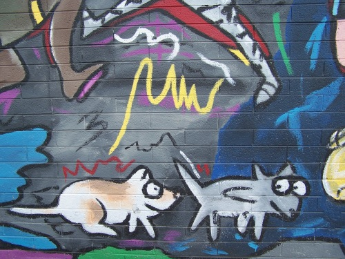 """Detail of """"The Buzzz"""" mural by animal lover and artist Fred Tieken"""