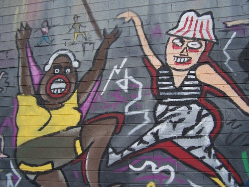 "Detail of Fred Tieken's ""The Buzzz"" mural capturing the spirit of Phoenix art walks"