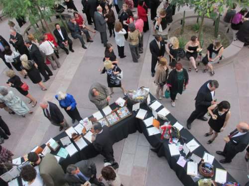 Balcony view of folks enjoying last year's pre-ceremony auction. Photo: Lynn Trimble