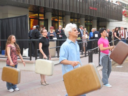 Step Raptis and fellow dancers integrate vintage luggage into movement art. Photo: Lynn Trimble