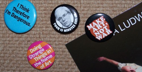 A few of the nifty buttons in the collections that grows each time I hit a museum gift shop